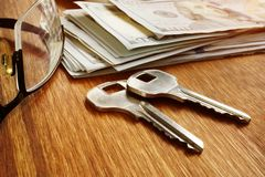 Rent apartments or buy property. Keys and money stock image