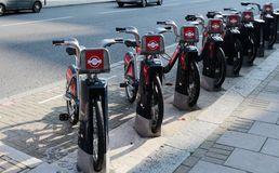 Rent a bike in London, UK 2015. Row of rental bikes from Santander Cycles. Santander Cycles is London's self-service, bike-sharing scheme for short journeys Stock Photos