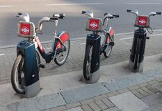 Rent a bike in London, UK 2015. Row of rental bikes from Santander Cycles. Santander Cycles is London's self-service, bike-sharing scheme for short journeys Stock Images
