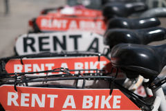 Rent a bike, row of rental bicycles Royalty Free Stock Images
