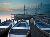 Rent a boat. Rental boats in an marina during sunrise Royalty Free Stock Photo