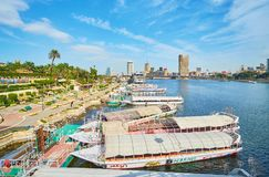Rent a boat in Cairo, Egypt. CAIRO, EGYPT - DECEMBER 24, 2017: The  harbor of Gezira Island with rental boats point and agencies, offering trips along the Nile Stock Photography