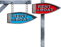 Rent a Boat - Directional Signs. Two wooden directional signs with pole, in the shape of row boat with text Rent a Boat.  on white background Stock Photos