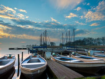 Rent a boat marina. Rental boats in an harbor during sunrise Royalty Free Stock Image