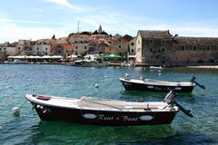 Rent a boat in Primosten. In Croatia Stock Images