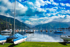 Rent-a-boat service at Zell Am See, Austria, Europe. Rent-a-boat service in park. Panoramic view of Zeller See lake. Zell Am See, Austria, Europe. Boats on Stock Photo