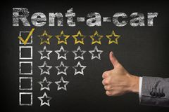 Rent-a-car five 5 star rating. thumbs up service golden rating stars on chalkboard.  stock images