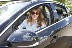 Rent a car. Portrait of middle aged woman hire a car and driving Royalty Free Stock Images