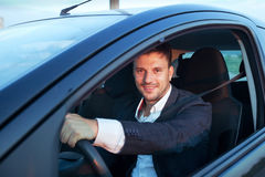 Rent a car. Smiling happy caucasian young man driving Stock Image