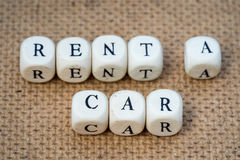 Rent a car. Words made from toy cubes with letters stock image