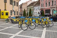Rent of city bicycles in the Square of Council Market in the Old Town of Brasov in Romania Stock Image