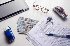 Rent contract with keys and us money on office table.  Stock Photo