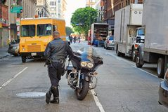 Rent a cops on the scene of a movie shoot in downtown Los Angeles. Hollywood frequents the streets of L.A. for the making of their video products, and they Royalty Free Stock Photography