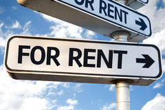 For Rent direction sign on sky background Royalty Free Stock Photography