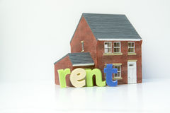 Rent lease house concept with model house and letters Royalty Free Stock Images