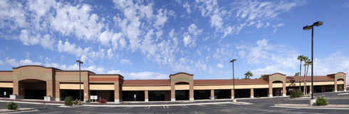For Rent or Lease. Vacant business offices and shopping mall with empty parking lot for rent or lease in Phoenix, AZ Royalty Free Stock Images