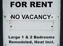 For rent no vacancy sign. Before old apartment building stock photography