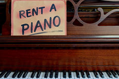 Rent a Piano Sign. On piano keyboard royalty free stock photography