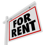 For Rent Real Estate Home Rental House Sign. The words For Rent on a house or apartment property for rental or lease to someone needing temporary residence Stock Photo
