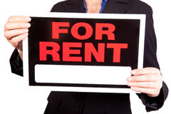 For rent real estate sign. Woman holding for rent sign - isolated on white background royalty free stock images