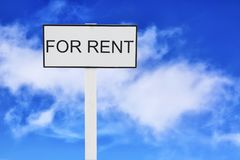 For Rent real estate sign against nice blue sky background with clouds.  royalty free stock photos