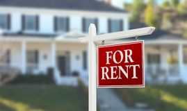For Rent Real Estate Sign In Front of Beautiful House Stock Image