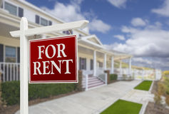 For Rent Real Estate Sign in Front of House. Red For Rent Real Estate Sign in Front of Beautiful House stock images