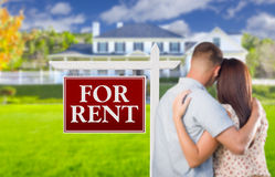 For Rent Real Estate Sign, Military Couple Looking at House. For Rent Real Estate Sign and Affectionate Military Couple Looking at Nice New House stock photos