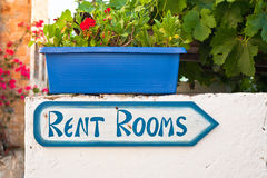 Rent rooms sign. Sign for holiday accommodation in a Greek village Royalty Free Stock Photos