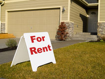 For Rent Sign. A close up on a sign in front of a house Stock Images