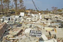 For Rent sign and debris in front of house heavily hit by Hurricane Ivan in Pensacola Florida Royalty Free Stock Photography