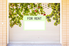 For rent sign in front of house. Stock Photo