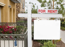 For rent sign with homes in background stock image