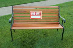FOR RENT sign on a park bench Stock Photo