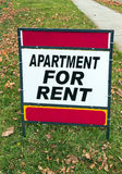 For Rent Sign. Red and White For Rent Sign on Lawn royalty free stock photos