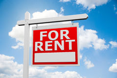For Rent signpost on sky Royalty Free Stock Images