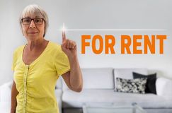 For rent touchscreen is shown by senior Royalty Free Stock Photo