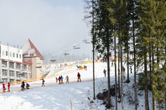 Rent wooden houses in the ski resort of Bukovel - Ukraine. Winter holidays. Royalty Free Stock Photos
