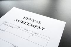 Rental agreement. Form on desktop in business office showing real estate concept Royalty Free Stock Photos