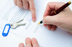 Rental agreement. Form with signing hand and keys and pen Stock Photos