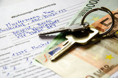 Rental agreement for an apartment with Euros and set of keys Stock Image