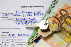 Rental agreement for an apartment with Euros and set of keys Royalty Free Stock Photography