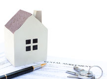 Rental agreement contact with an architectural model and a calculator and pen and keys no logo or trademark. Clipping path included Royalty Free Stock Photos