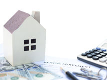 Rental agreement contact with an architectural model and a calculator and pen and keys and USD dollars. No logo or trademark clipping path included Royalty Free Stock Photo