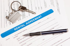 Rental agreement form. Close up of lease agreement empty document with pen Royalty Free Stock Image