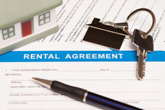 Rental agreement form. Close up of lease agreement empty document with pen Royalty Free Stock Images