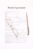 Rental agreement form with pen and glasses Stock Photos