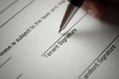 Rental agreement. Form with signing hand and pen Stock Image