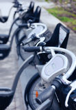 Rental bicycle pick up station in the city street Royalty Free Stock Photos