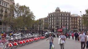 Rental bicycles at Placa de Catalunya in Barcelona stock video footage